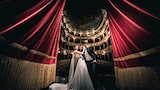 cristiano-ostinelli-sony-alpha-9-bride-and-groom-standing-in-the-wings-of-an-opera-house