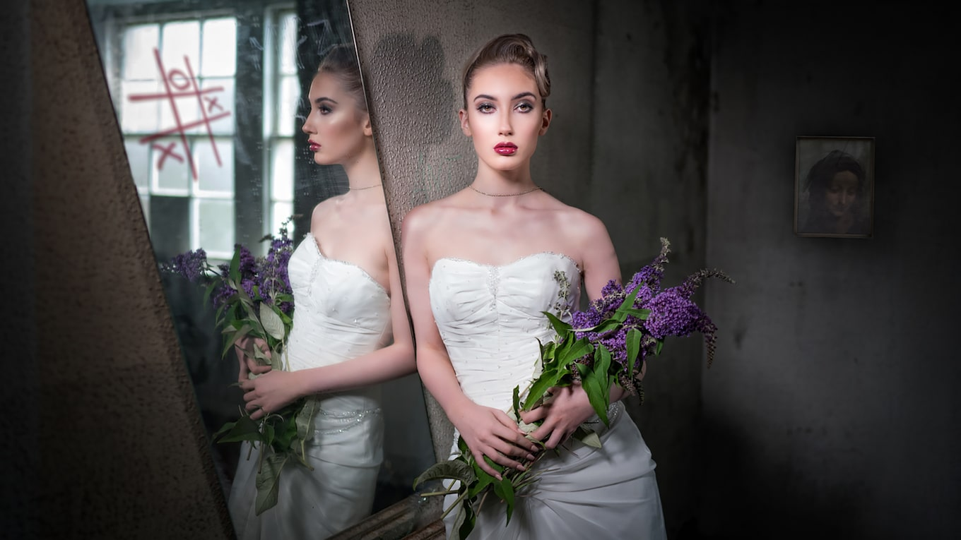 terry-donnelly-sony-alpha-9-bride-leaning-against-wall-and-reflected-in-mirror